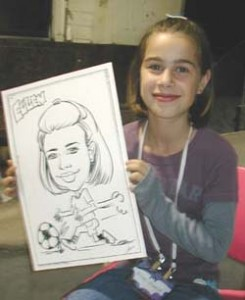 Caricature artist drawing of a girl at an employee picnic.
